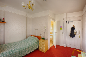 Heaton House bedroom showing ensuite bathroom